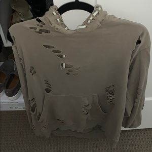hoodie with stylish holes throughout